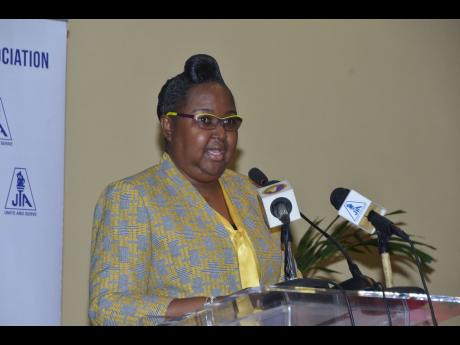 Dr Grace McLean, acting permanent secretary in the Ministry of Education, Youth and Information, giving the keynote address at the Jamaica Teachers' Association's 18th Annual Education Conference in Montego Bay, St James, yesterday.
